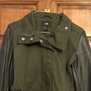 Green military jacket with leather sleeves